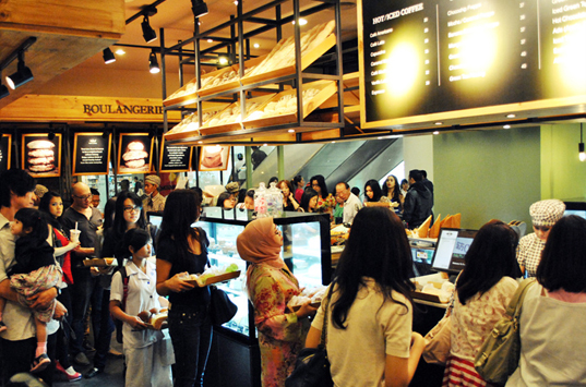 Customers crowd into the 8th Indonesian store.